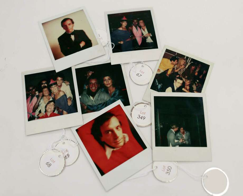 This Jan. 16, 2013 photo shows various polaroids shot by Andy Warhol at Studio 54 on display in West Palm Beach, Fla. Memorabilia from the famed 1970s club is hitting the auction block in Florida. The private collection of co-founder Steve Rubell is being sold Saturday in West Palm Beach. (AP Photo/Alan Diaz) Photo: Alan Diaz