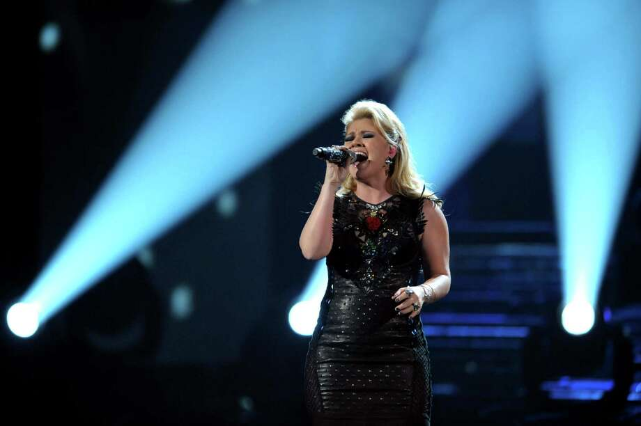FILE - In this Nov. 18, 2012 file photo, Kelly Clarkson performs a medley of her songs at the 40th Annual American Music Awards, in Los Angeles.  Clarkson and fun. are just two of the acts who will perform during the upcoming inaugural festivities, which also includes Beyonce, James Taylor, Stevie Wonder, Katy Perry and dozens of others. (Photo by John Shearer/Invision/AP, File) Photo: John Shearer