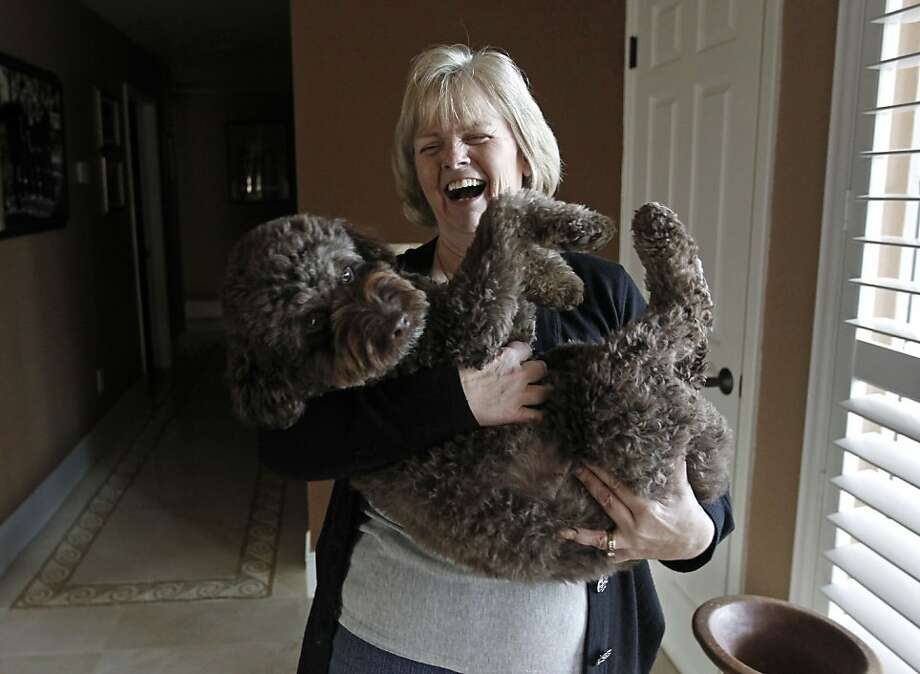 Teresa Kaepernick holds the family dog, Sookie, at their home in Modesto. Unlike Teresa's son Colin, Sookie is no athlete. Photo: Michael Macor, The Chronicle