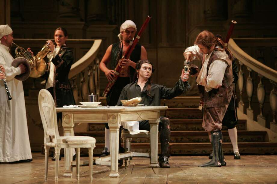"Mariusz Kwiecien, seated, and Oren Gradus, right, star in Houston Grand Opera's production of ""Don Giovanni."" Photo: Brett Coomer"