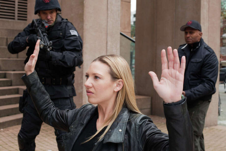 FRINGE: Olivia (Anna Torv, C) surrenders in the all-new Liberty, Part One of the 100th episode and special two-hour series finale of FRINGE airing Friday, Jan. 18  (8:00-10:00 PM ET/PT) on FOX. ©2012 Fox Broadcasting Co. CR: Liane Hentscher/FOX