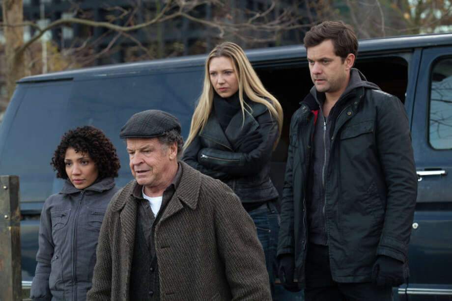 FRINGE: Astrid (Jasika Nicole,  L), Walter (John Noble, C), Olivia (Anna Torv, second from R) and Peter (Josh Jackson, R) prepare for a mission in the all-new Liberty, Part One of the 100th episode and special two-hour series finale of FRINGE airing Friday, Jan. 18  (8:00-9:00 PM ET/PT) on FOX. ©2012 Fox Broadcasting Co. CR: Liane Hentscher/FOX