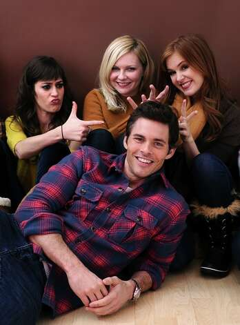 Actors Lizzy Caplan, Kirsten Dunst, Isla Fisher and James Marsden pose for a portrait during the 2012 Sundance Film Festival at the Getty Images Portrait Studio at T-Mobile Village at the Lift on January 22, 2012 in Park City, Utah. Photo: Larry Busacca, Getty Images / 2012 Getty Images