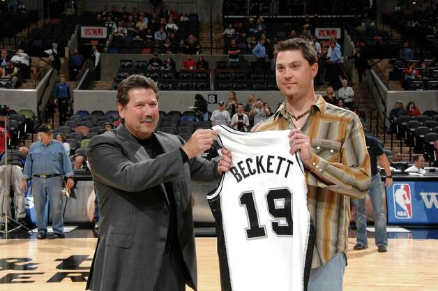 Josh Beckett is presented with his own Spurs jersey from Russ Bookbinder, Spurs Executive Vice President, on November 7, 2007 at the AT&T Center in San Antonio, Texas.  (D. Clarke Evans/NBAE via Getty Images) Photo: D. Clarke Evans, Express-News / 2007 NBAE