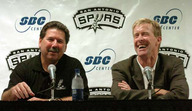 Former San Antonio Spurs mascot Tim Derk (right), better known as the Coyote, laughs as San Antonio Spurs executive vice president of business operations for Spurs Sports and Entertainment Russ Bookbinder makes an announcement at a press conference at the SBC Center on Monday August 30, 2004. They announced that Derk would become the manager of mascot development for Spurs Sports and Entertainment. Derk suffered from a stroke after 21 years as the Spurs Coyote and is still recovering, but doing well. JOHN DAVENPORT / EXPRESS-NEWS Photo: JOHN DAVENPORT, Express-News / SAN ANTONIO EXPRESS-NEWS