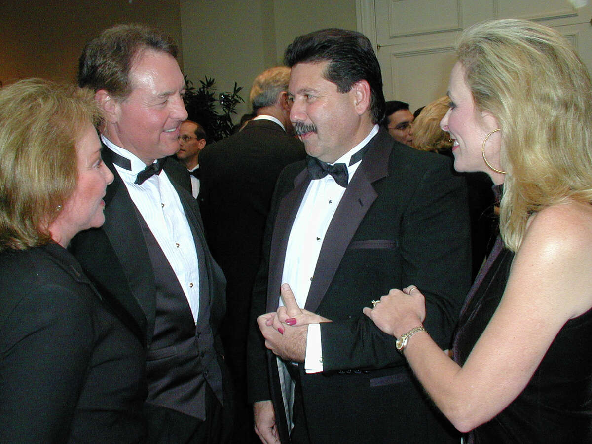 Julianna Holt (spouse), Peter Holt (honoree), Russ Bookbinder and Tammy Bookbinder (co hosts) were at the Westin Riverwalk hotel on Jan. 10, 2002, for the honoring of Peter Holt by National Multiple Sclerosis Society. Leland A. Outz/For the Express-News