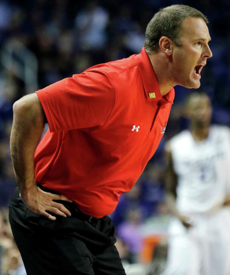 Lamar head coach Pat Knight shouts to his players during the first half of an NCAA college basketball game against Kansas State, Monday, Nov. 12, 2012, in Manhattan, Kan. (AP Photo/Charlie Riedel) Photo: Charlie Riedel, STF / AP