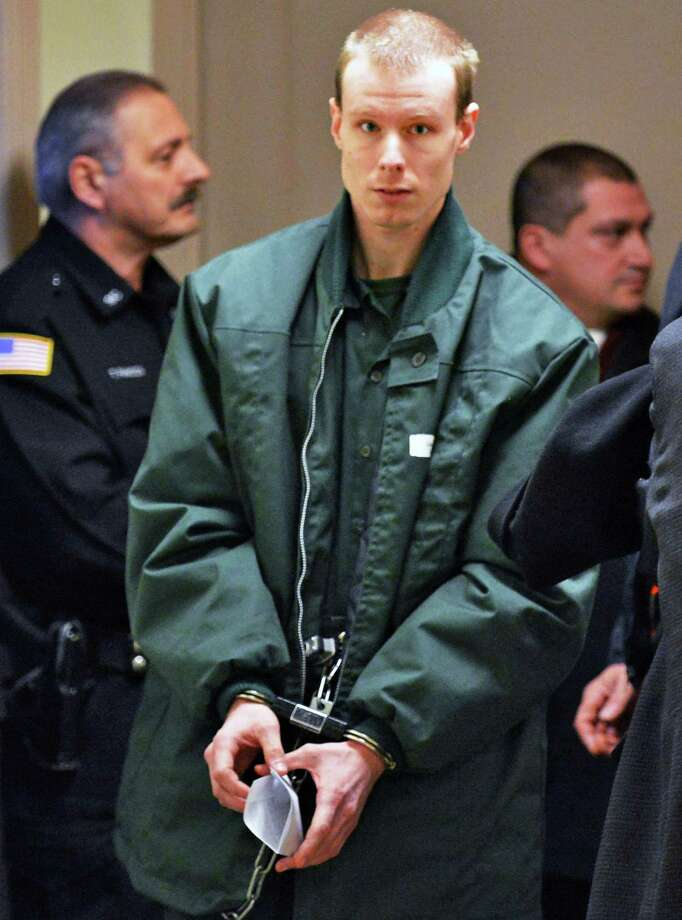 Christopher Gallup is lead through the Schenectady County Courthouse Friday Jan. 18, 2013. Gallup is charged with two counts of second-degree rape. (John Carl D'Annibale / Times Union) Photo: John Carl D'Annibale