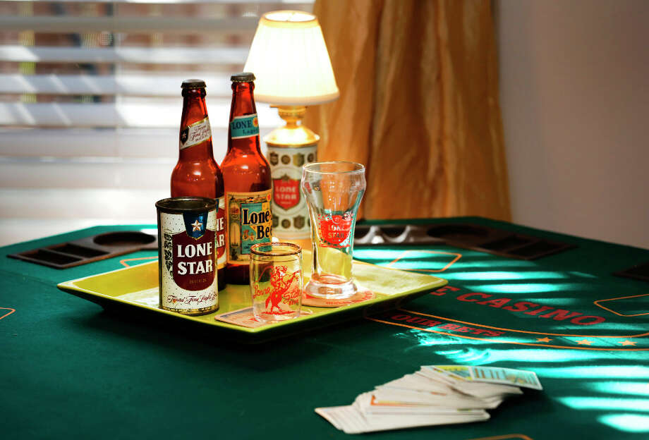 Lone Star beer collectables on a poker table in the game room in the home of David Strahan and Katherine McMillan.  Thursday, Jan. 17, 2013. Photo: BOB OWEN, San Antonio Express-News / © 2012 San Antonio Express-News