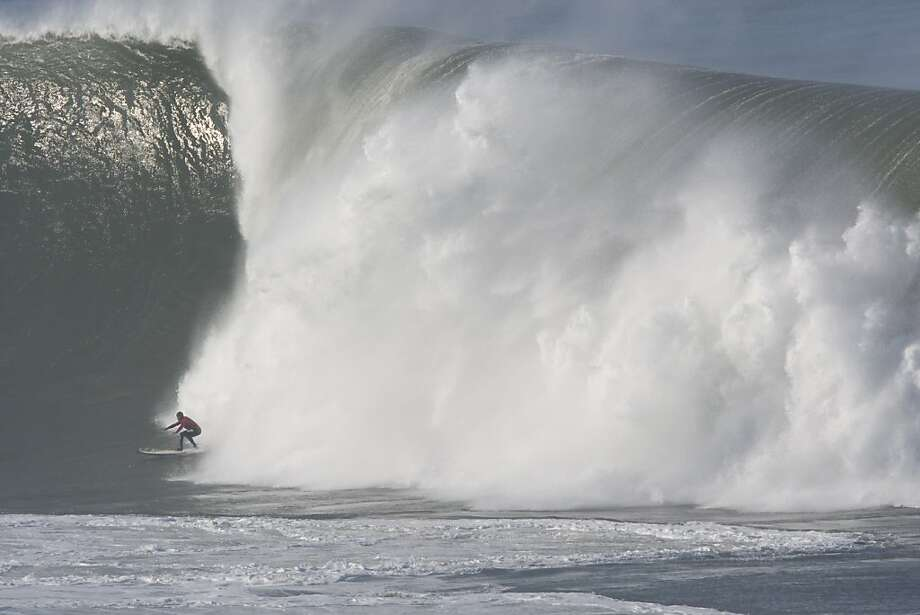 Surfers were dwarfed by waves at Mavericks in 2010 and even carefully avoided some monster curls with faces up to 60 feet. Sunday's forecast is for manageable sets roughly half as tall. Photo: Adam Lau, The Chronicle