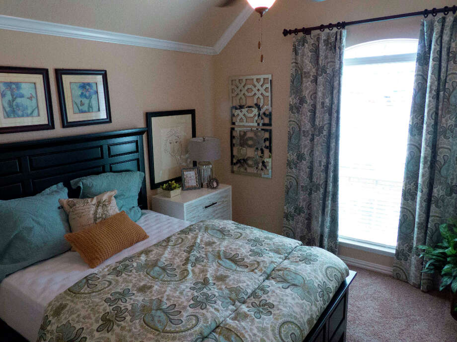 The bedroom in the Lennar's NextGen at 4919 Isaac Ryan, which is essentially two homes in a home. Photo: Billy Calzada, San Antonio Express-News / SAN ANTONIO EXPRESS-NEWS