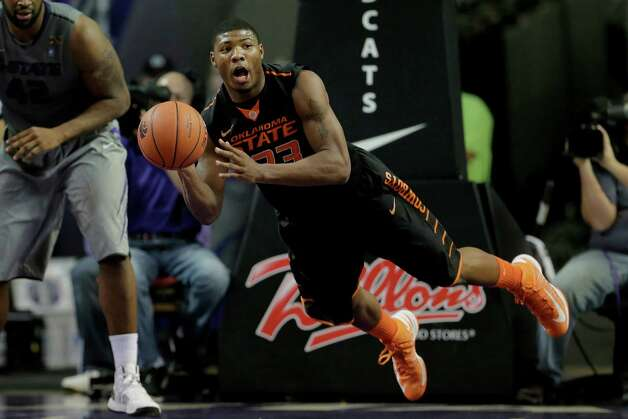 Oklahoma State guard Marcus Smart passes the ball  during the first half of an NCAA college basketball game against Kansas State Saturday, Jan. 5, 2013, in Manhattan, Kan. (AP Photo/Charlie Riedel) Photo: Charlie Riedel, Associated Press / AP