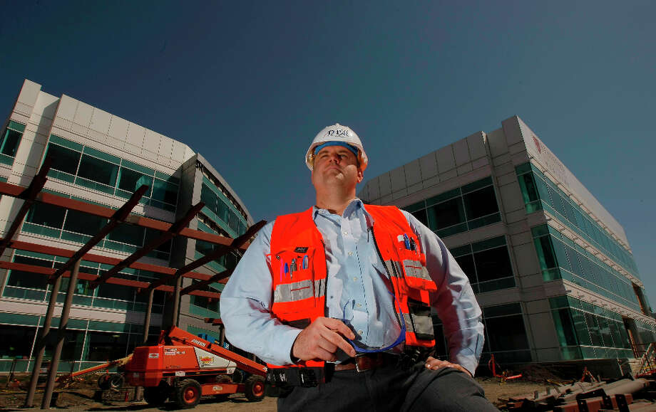 15. DPR ConstructionNo. of employees:1,371Fortune said this Redwood City construction company 'has the feel of a Silicon Valley startup,' with bagel breakfasts and bring-your-dog-to-work days. In this picture from April 15, 2008, regional manager George Pfeffer stands outside one of DPR Construction's projects. Photo: Michael Macor, SFC / The Chronicle