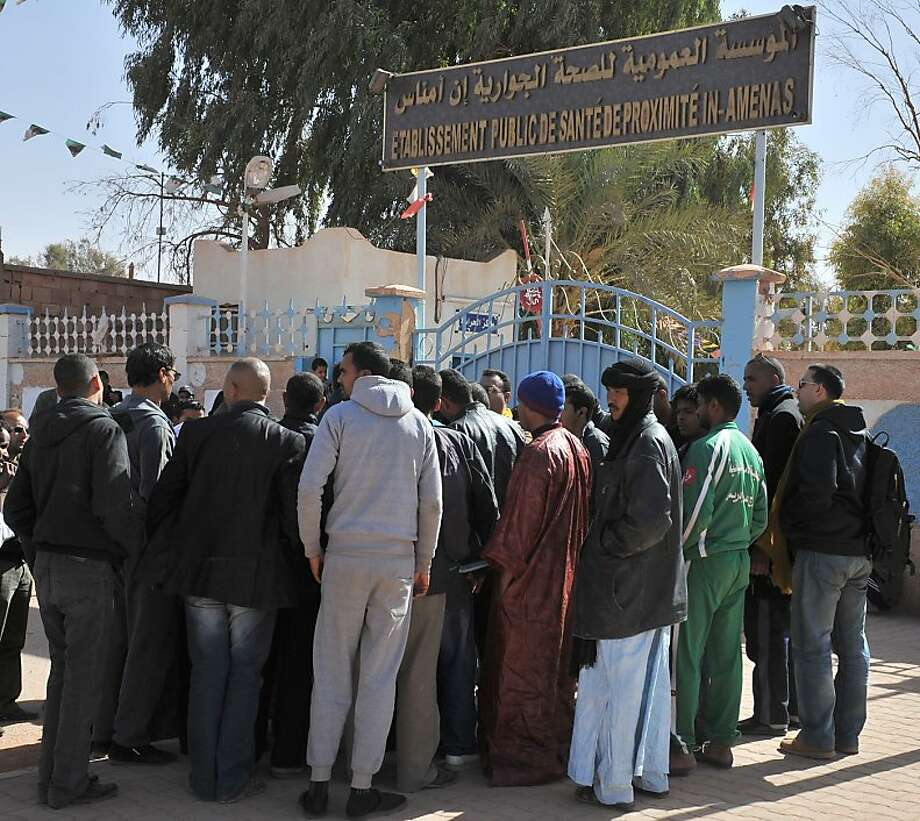 Residents of Ain Amenas, Algeria, gather outside a hospital trying to get information concerning relatives wounded during a terrorist attack at a natural gas plant in the Sahara Desert. The Algerian government says 18 kidnappers and at least  12 captives, including one American, were killed when their forces stormed the complex. Photo: Anis Belghoul, Associated Press