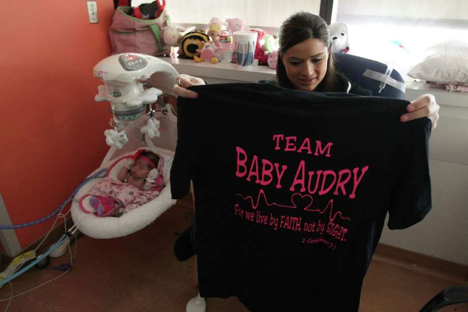 "Ashley Cardenas views her ""Team Baby Audry"" shirt as she talks about all the support from family and friends she has received . Photo: Mayra Beltran, Houston Chronicle / © 2012 Houston Chronicle"