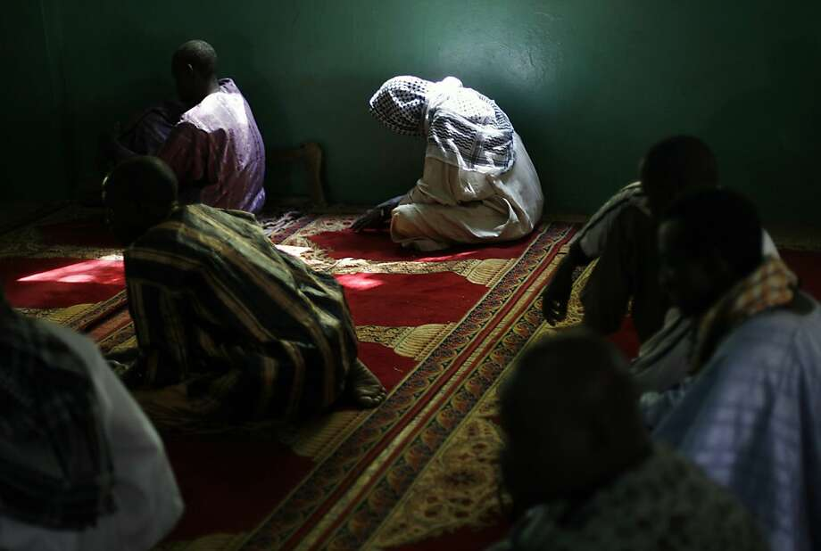 Worshipers pray in a mosque in Banamba, Mali. Islamist militants quietly retreated from two towns they had seized after France sent troops and air power to halt their advance. Photo: Jerome Delay, Associated Press