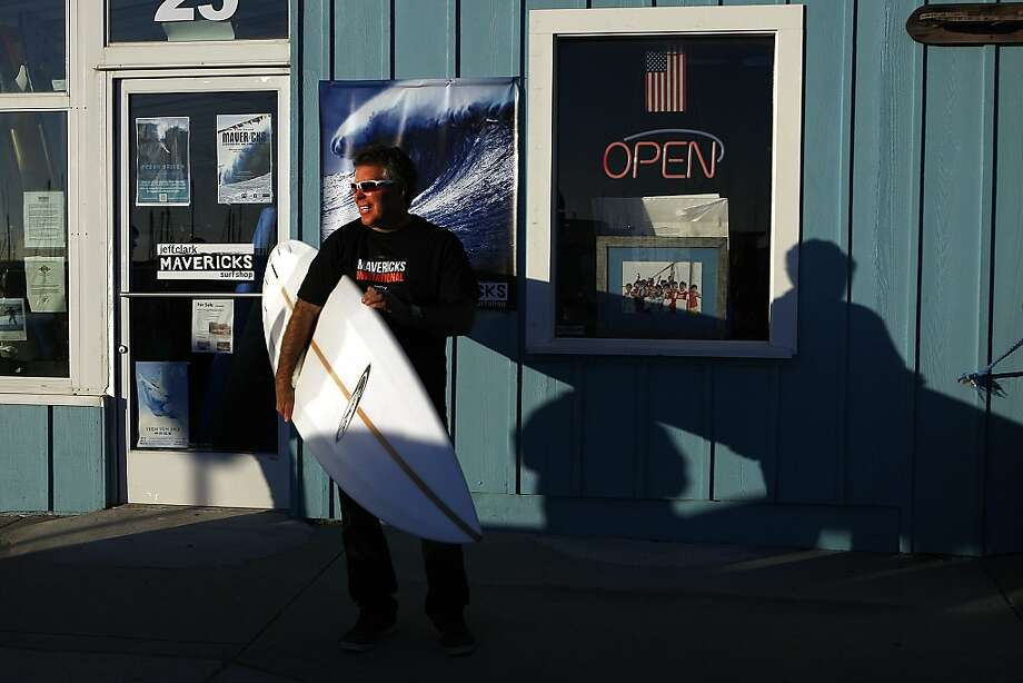 Jeff Clark shows off a surfboard he created - built for the high speeds necessary to surf Mavericks. Photo: Sean Havey, The Chronicle
