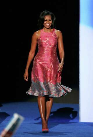 CHARLOTTE, NC - SEPTEMBER 04:  First lady Michelle Obama takes the stage during day one of the Democratic National Convention at Time Warner Cable Arena on September 4, 2012 in Charlotte, North Carolina. The DNC that will run through September 7, will nominate U.S. President Barack Obama as the Democratic presidential candidate. Photo: Alex Wong, Getty Images / 2012 Getty Images