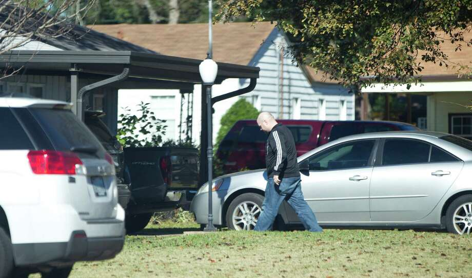 An unidentified man walks into the house belonging to the brother of one of the American hostages being held by al-Qaida-linked militants, Friday, Jan. 18, 2013. The family of the man is not allowing interviews due to the FBI warning not to conduct any interviews until the situation is under control. Photo: Karen Warren, Houston Chronicle / © 2013 Houston Chronicle
