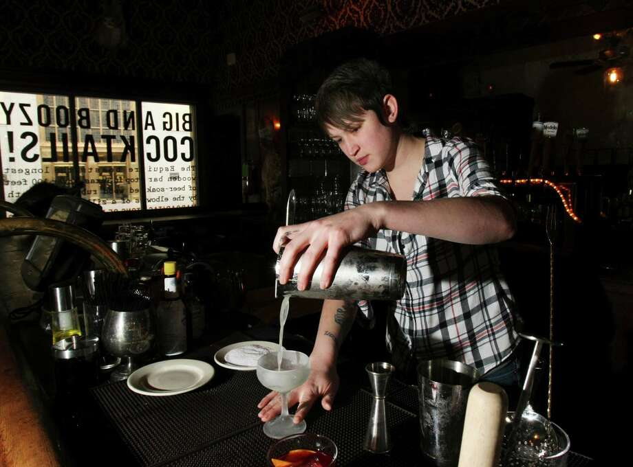 Bartender Karah Carmack is one of two local bartenders who will be competing in Speed Rack. The event was created by and for women and has been described as the roller derby of female bartender competitions. Photo: Helen L. Montoya, SAN ANTONIO EXPRESS-NEWS / SAN ANTONIO EXPRESS-NEWS