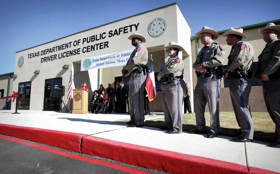 DPS officers line the front of the new Leon Valley Mega Center on Evers Road during opening ceremony. Photo: Bob Owen, San Antonio Express-News / ©2013 San Antonio Express-News