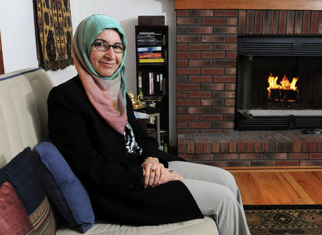 Ilham AlMahamid sits in her home on Tuesday Jan. 15, 2013 in Slingerlands, N.Y. Ilham is originally from Syria and still has family there. (Lori Van Buren / Times Union) Photo: Lori Van Buren