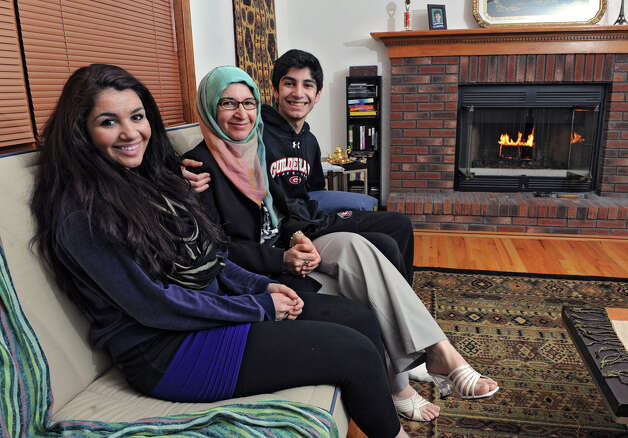 Ilham AlMahamid sits in her home with her children Hajar Alrifai, 17, left, and Omar Alrifai, 15,  on Tuesday Jan. 15, 2013 in Slingerlands, N.Y. Ilham is originally from Syria and still has family there. (Lori Van Buren / Times Union) Photo: Lori Van Buren