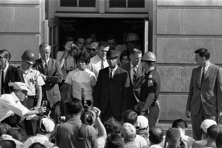 "FILE - In this June 11, 1963 file photo, Vivian Malone and James Hood stand in the doorway of Foster Auditorium where they hold what they called their ""first and final news conference"" after the two African-American students registered at the University of Alabama at Tuscaloosa, Ala. Earlier, Gov. George Wallace had barred their way from the same doorway. Hood, one of the first black students at the University of Alabama, has died. He was 70. Officials at Adams-Buggs Funeral Home in Gadsden said they are handling arrangements for Hood, who died Thursday, Jan. 17, 2013. Details concerning Hood's funeral are not complete, funeral home officials said. (AP Photo/File) Photo: Uncredited, Associated Press / AP"