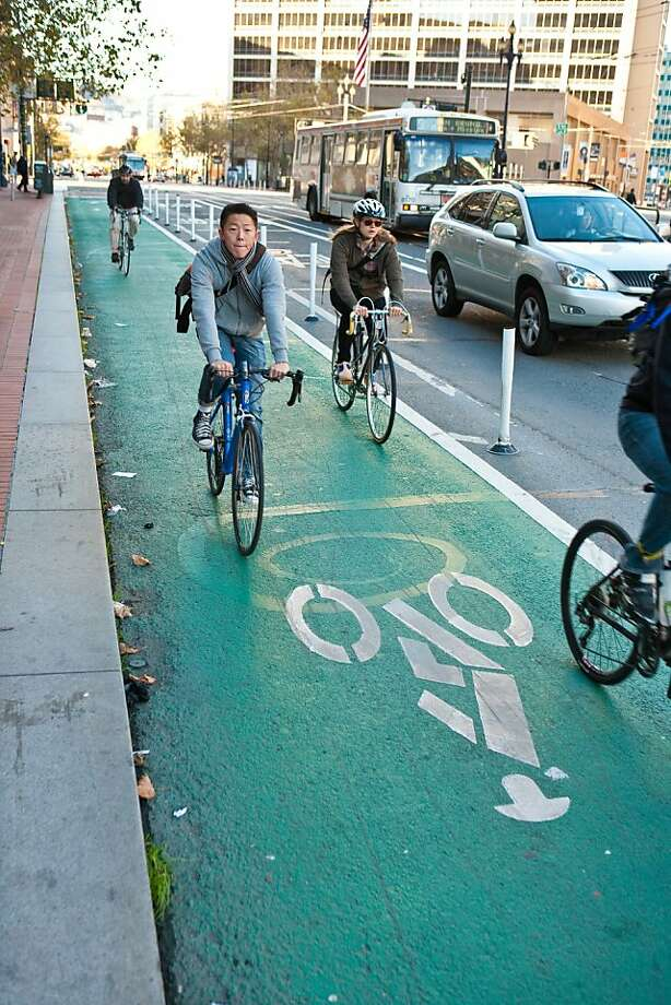 Cyclists pedal along Market Street in one of San Francisco's increasing number of protected bicycle lanes. It's one example of the city's dedication to a safe environment for two-wheelers. Photo: S.F. Bicycle Coalition