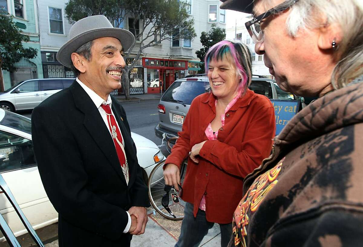 S.F. Poet Laureate Alejandro Murguía (left) visits with Kate Rasenberger and Michael Roman in the Mission District.