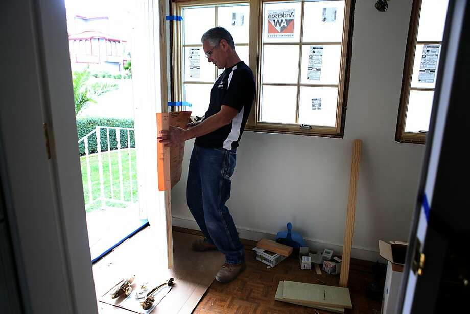 Former SFPD Deputy Chief Rick Bruce works on a door frame while remodeling a San Bruno home. Bruce has rebuilt his life as a contractor after leaving the department. Photo: Liz Hafalia, The Chronicle