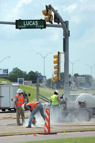 Workers prepare an area of Lucas Drive near U.S. 69 for a sidewalk that will span from the highway to Concord Road. The city has $800,000 worth of projects planned for Lucas Drive. Photo taken Monday, June 4, 2012 Guiseppe Barranco/The Enterprise Photo: Guiseppe Barranco, STAFF PHOTOGRAPHER / The Beaumont Enterprise