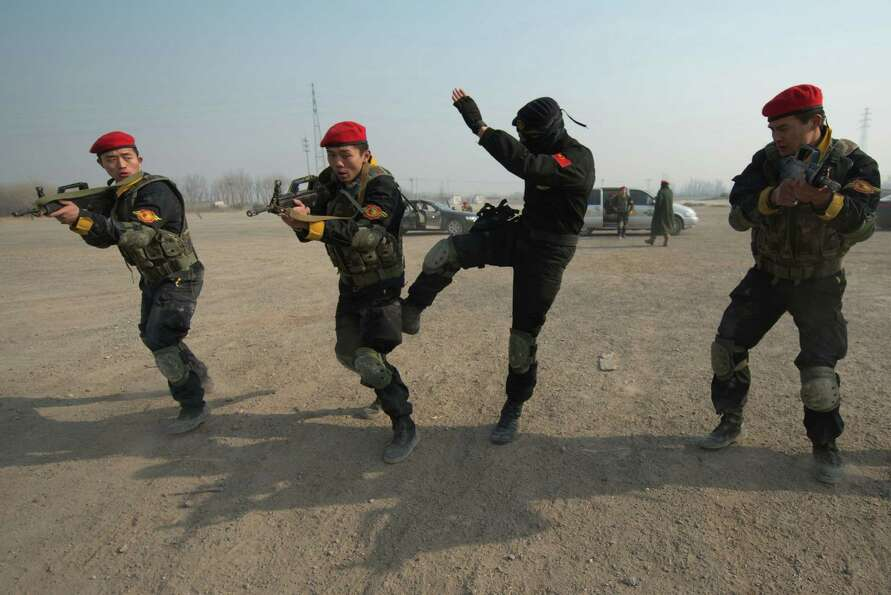 A trainee bodyguard of the Genghis Security Academy is reprimanded by instructor Marco Borges (2nd R
