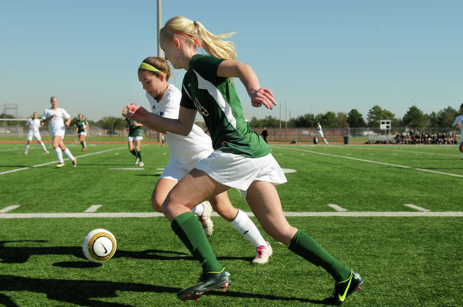 The Woodlands sophomore forward Stephanie Evans, from right, battles for the ball against Clements senior midfielder Savannah LaRicci during their Cougar Bracket semi-final match of the I-10 Shootout at Cinco Ranch High School on Friday. Photo by Jerry Baker Photo: Jerry Baker, For The Chronicle