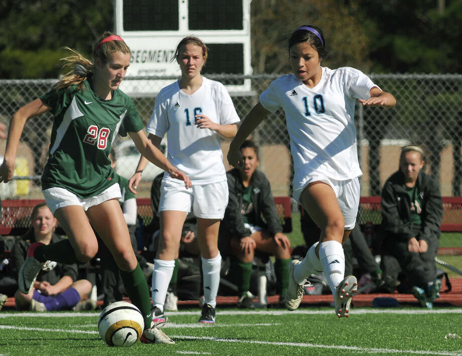 The Woodlands senior forward Kaleigh Olmsted, from left, keeps the ball away from Clements senior midfielder Tiffani Echeverria during their Cougar Bracket semi-final match of the I-10 Shootout at Cinco Ranch High School on Friday. Photo by Jerry Baker Photo: Jerry Baker, For The Chronicle