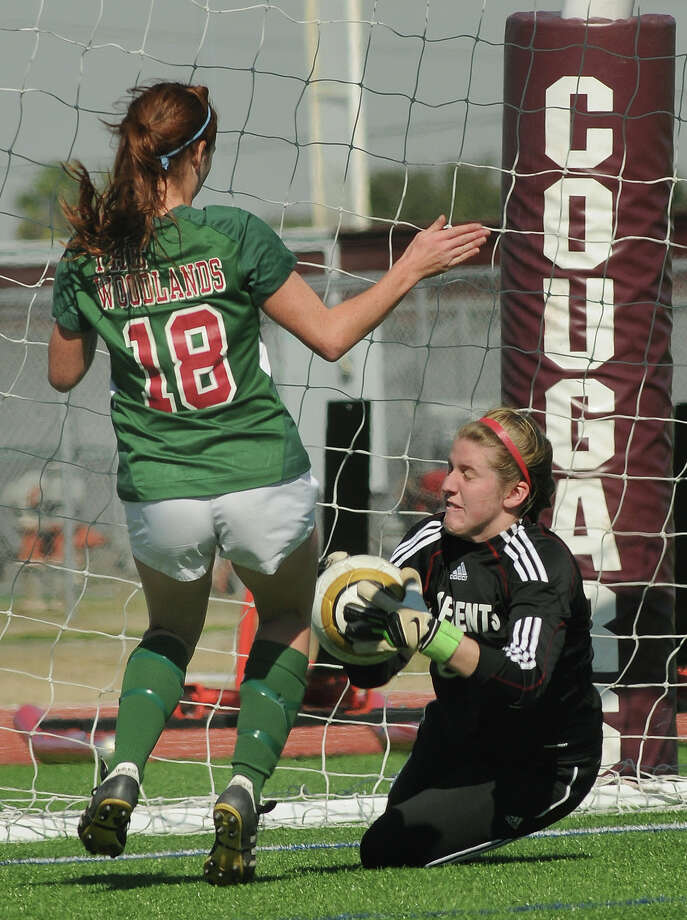 Clements sophomore goalkeeper Regan Hermes, from right, makes a save in front of The Woodlands junior midfielder Carissa Cannizzaro during their Cougar Bracket semi-final match of the I-!0 Shootout at Cinco Ranch High School on Friday. Photo by Jerry Baker Photo: Jerry Baker, For The Chronicle