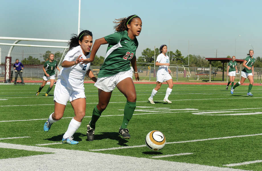 The Woodlands sophomore midfielder Taylor Campbell, from right, keeps the ball away from Clements junior forward Guadalupe Rodriguez during their Cougar Bracket semi-final match of the I-10 Shootout at Cinco Ranch High School on Friday. Photo by Jerry Baker Photo: Jerry Baker, For The Chronicle