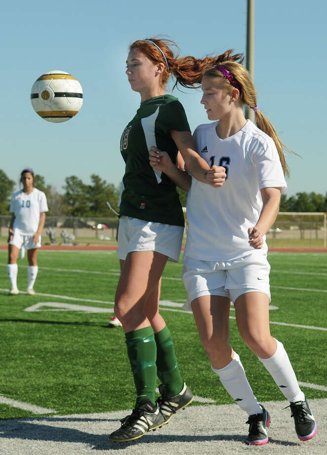 The Woodlands junior midfielder Carissa Cannizzaro, from left, keeps the ball away from Clements senior midfielder Lizzy Denton during their Cougar Bracket semi-final match of the I-10 Shootout at Cinco Ranch High School on Friday. Photo by Jerry Baker Photo: Jerry Baker, For The Chronicle