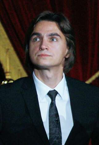 FILE - In this Friday, Oct. 28, 2011 file photo the Bolshoi Theater Sergei Filin artistic director visits a gala opening of the Bolshoi in Moscow,  Russia. The Moscow police said Friday, Jan. 18, 2013, that artistic director at the legendary Bolshoi Theater Sergei Filin was attacked Thursday night by a man who splashed acid onto his face as the 43-year-old former dancer came out of his car outside his home in central Moscow.  (AP Photo/RIA Novosti, Vladimir Rodionov, Presidential Press Service, File) Photo: Vladimir Rodionov