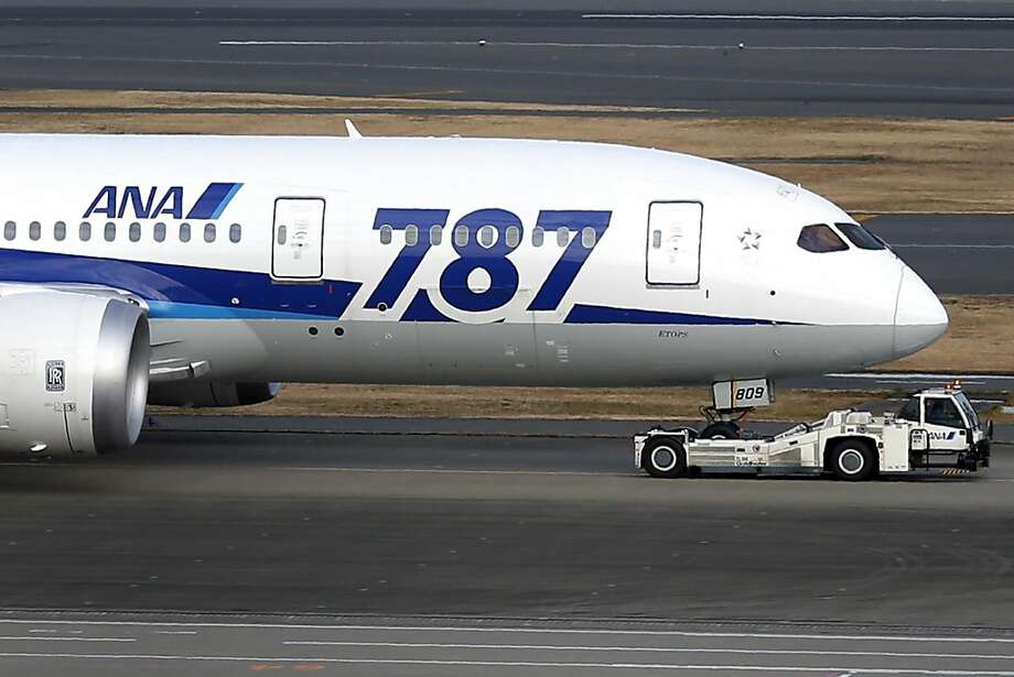 A Dreamliner taxis at Haneda Airport in Tokyo on Wednesday. Boeing is suspending deliveries of the aircraft until it can satisfy an FAA directive. Photo: Kiyoshia Ota, Bloomberg