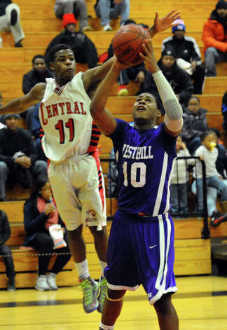 Central's #11Tyker Ancrum comes in from behind to block a shot attempt by Westhill's #10 Yveson Cassamajor, during boys basketball action in Bridgeport, Conn. on Friday January 18, 2013. Photo: Christian Abraham / Connecticut Post