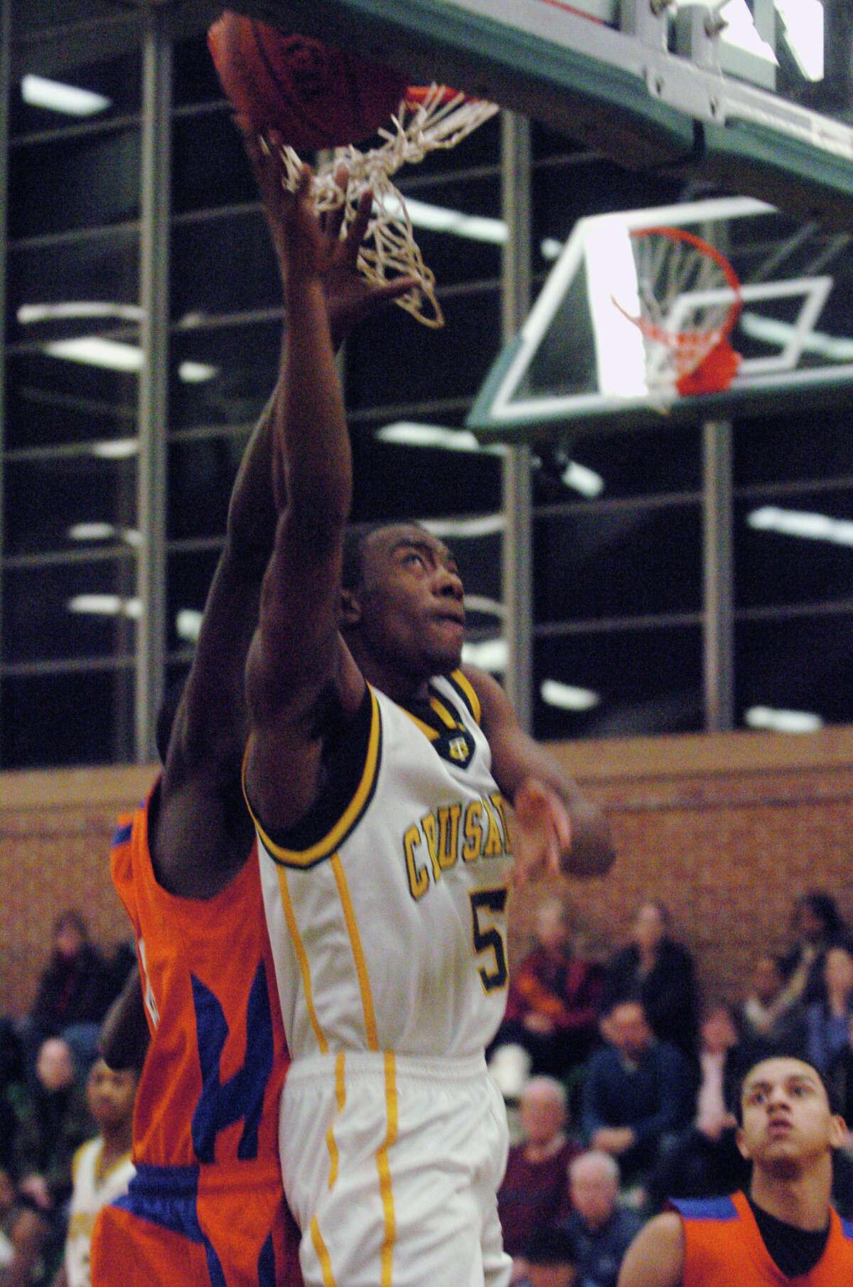 Trinity's Brandon Wheeler puts the ball up as Trinity Catholic hosts Danbury High School in a boys basketball game in Stamford, Conn., Jan. 18, 2013.
