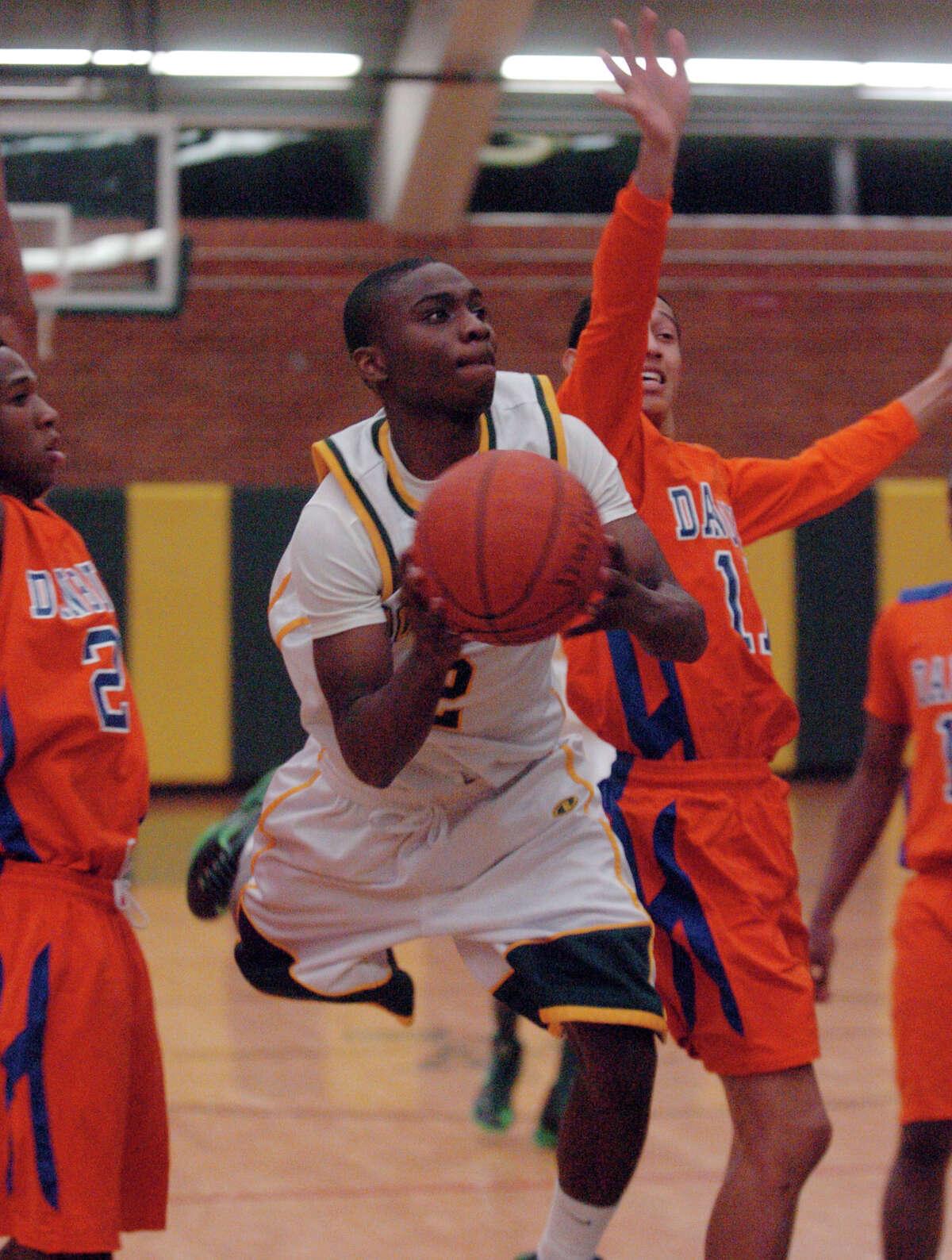 Trinity's Schadrac Casimir breaks through the Danbury defense as Trinity Catholic hosts Danbury High School in a boys basketball game in Stamford, Conn., Jan. 18, 2013.