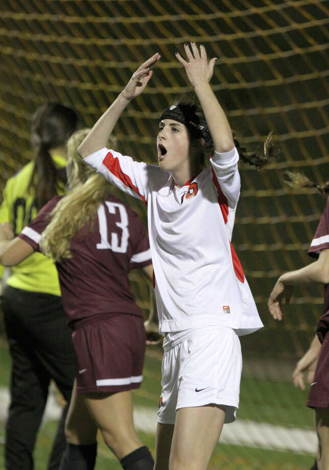 Memorial's Grace Miller reacts to just missing a header over the goal against Austin during the I-10 Shootout Tournament at Rhodes Stadium in Katy, Texas,  Thursday, Jan. 17, 2013. (AP Photo/The Courier, Alan Warren) Photo: Alan Warren, Associated Press / The Courier