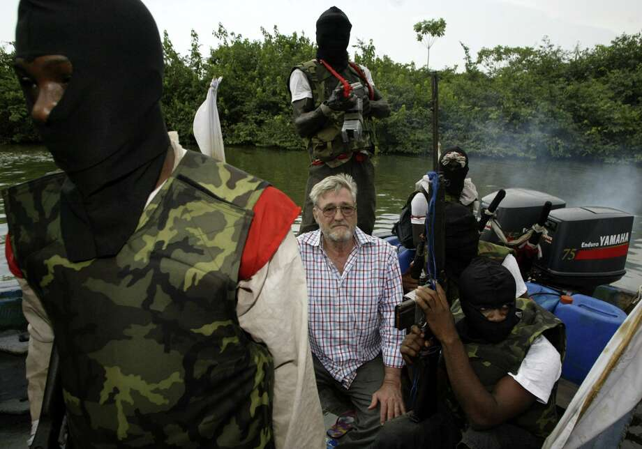 In 2006, Macon Hawkins, 68, from Kosciusko, was one of nine oil workers held hostage by militants in the Niger Delta. The kidnappers were demanding that people in the country's south receive a greater share of the region's oil wealth. Photo: GEORGE OSODI, STR / 2006 AP