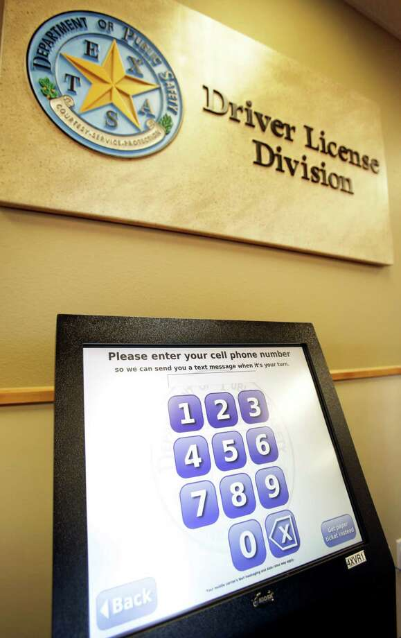 Department of Public Safety opened a new Mega Center in Leon Valley on Evers.  New kiosks will enable users to log in their cell number to reserve an appointment time or get a paper ticket with an appointment number. Photo: Bob Owen, San Antonio Express-News / ©2013 San Antonio Express-News