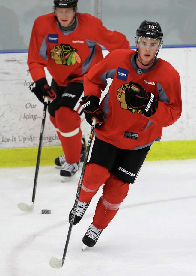 In this photo taken Jan. 14, 2013, Chicago Blackhawks' forwards Jonathan Toews, right, and Marian Hossa, of Slovakia, skate during NHL hockey practice in Chicago. The Blackhawks begin the lockout-shortened 48-game regular season against the Los Angeles Kings on Saturday in Los Angeles. (AP Photo/M. Spencer Green) Photo: M. Spencer Green, STF / AP