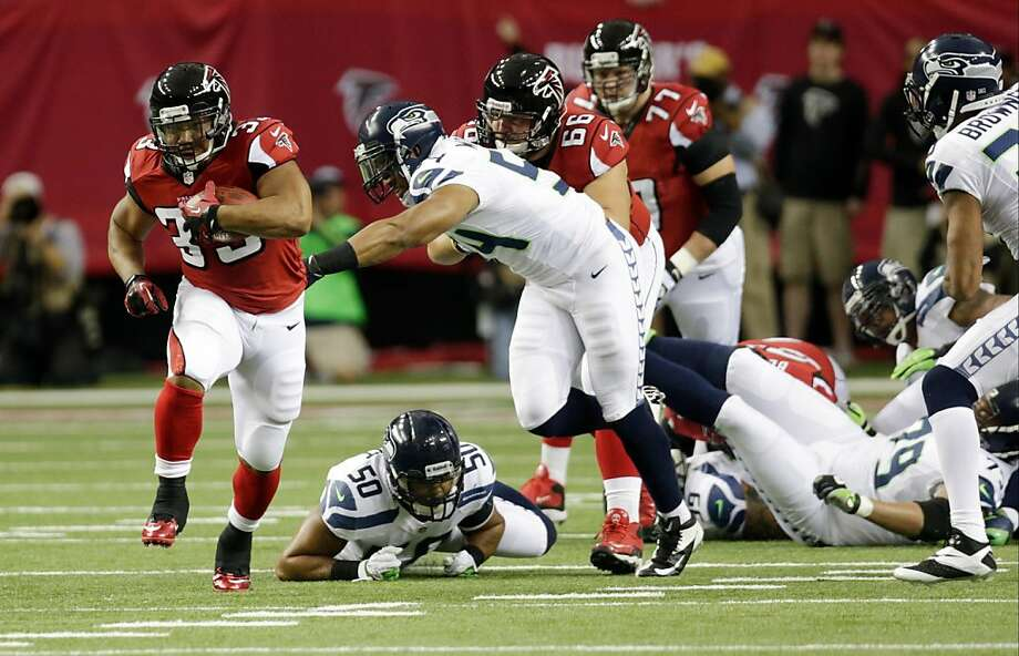 Michael Turner (left) had 98 of Atlanta's 167 rushing yards in its playoff victory over Seattle. Photo: Dave Martin, Associated Press