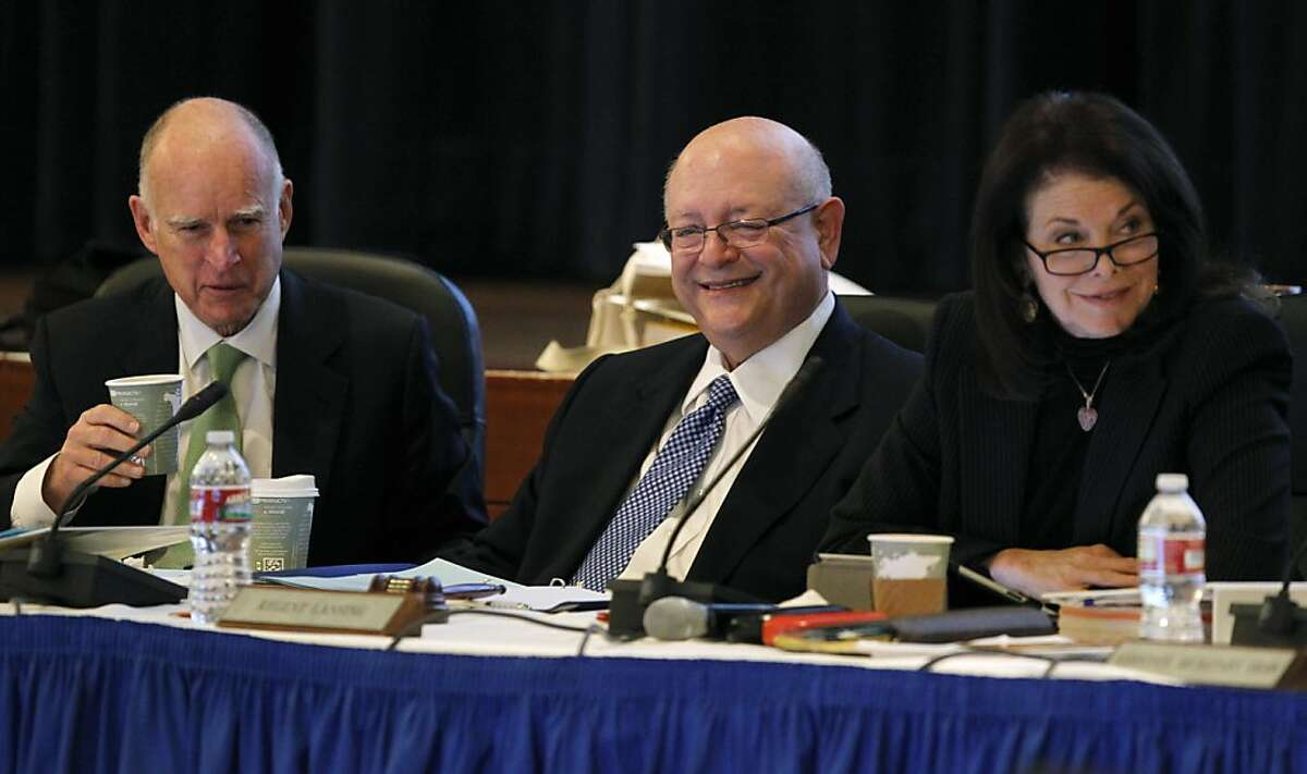 Gov. Jerry Brown, UC President Mark Yudof and Chairmwoman Sherry Lansing smile during the Board of Regents meeting at the UCSF Mission Bay campus in San Francisco, Calif. on Wednesday, Jan. 16, 2013, where the governor made a pitch for systemwide online education .