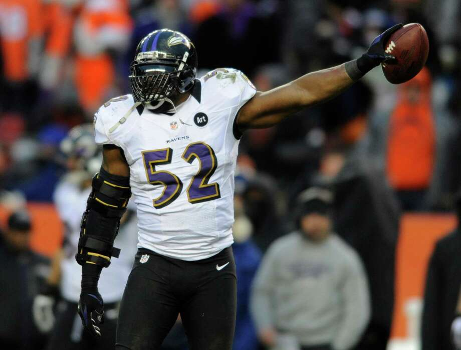 Baltimore Ravens inside linebacker Ray Lewis holds up the ball after recovering a fumble by Denver Broncos quarterback Peyton Manning (18) in the third quarter of an AFC divisional playoff NFL football game, Saturday, Jan. 12, 2013, in Denver. (AP Photo/Jack Dempsey) Photo: Jack Dempsey, Associated Press / FR42408 AP
